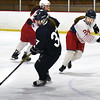 BRYAN EATON/Staff photo. Masconomet's Mikayla Vincent looks to move in on Winthrop's Miles who's moving the puck.