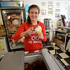 JIM VAIKNORAS/Staff photo Rian Vatcher, of Salisbury, serves up a scoop of peppermint ice cream at Simply Sweet on Inn Street in Newburyport Saturday.The shop has been busier than normal for late february due to resent warm weather.
