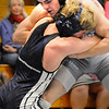 BRYAN EATON/Staff photo. Triton wrestler Jeremy Duford, top, with Marblehead/Swampscott's Cad Dubiel in the 126 class.