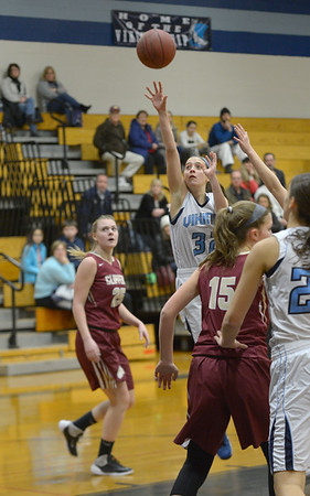 JIM VAIKNORAS/Staff photo Triton's Erin Savage shoots over Newburyport players during their game at Triton Friday night.