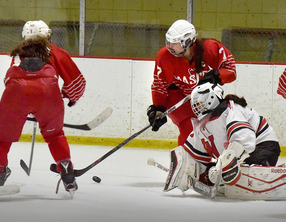 BRYAN EATON/Staff photo. Masconomet's Lexi Rosenbaum and Isabelle Sarra put pressure on the Winchester goalie.