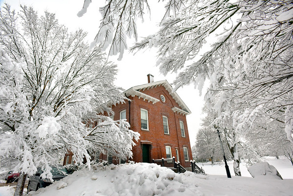 BRYAN EATON/Staff photo. The west side of the Newburyport Superior Courthouse is framed by snow-covered trees after close to five inches of snow fell overnight Wednesday into Thursday morning. It was built in 1805 and is considered to be the oldest, continuously used courthouse in the country.