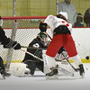 BRYAN EATON/Staff photo. Winthrop goalie Howard deflects a shot by Masconomet.