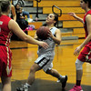JIM VAIKNORAS/Staff photo Triton's Izzy Cambece makes a move to the basket against Everett Wednesday night at Triton.