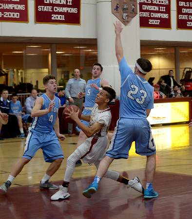 JIM VAIKNORAS/Staff photo   Newburyport's George MacRae drives to the basket against Triton during their game at Newburyport Friday night.