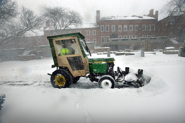 BRYAN EATON/Staff photo. The Newburyport Department of Public Services kept up with the snow Thursday afternoon, here making a pass up Inn Street.