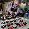 BRYAN EATON/Staff photo. Chococoa Baking Company owners Julie Ganong and Alan Mons, pictured, are selling themed whoopie pies for Valentine's Day