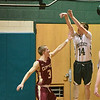 BRYAN EATON/Staff photo. Pentucket's Gus Flaherty gets two on this shot as Newburyport's Nicholas Rogers covers.