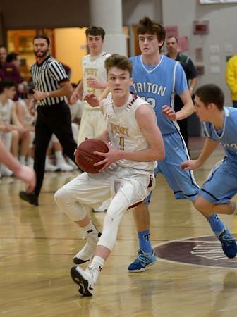 JIM VAIKNORAS/Staff photo   Newburyport'sBob Shay drives to the basket against Triton during their game at Newburyport Friday night.