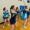 JIM VAIKNORAS/Staff photo Triton's cheerleaders cheer at the Viking's home game Friday night against Pentucket. Their school spirit was not in vain as the home team defeated the Sachems 55-52.