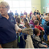 JIM VAIKNORAS/Staff photo Susan St John from the Drumlin Farm shows off a kestrel at the Joppa Flats Audubon Center during the annual Eagle Festival Saturday afternoon.
