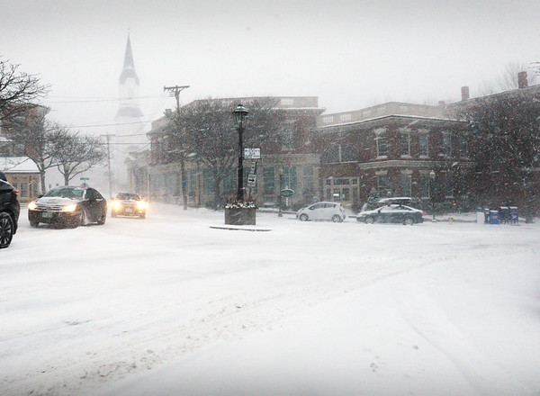 BRYAN EATON/Staff photo. Cars take it easy at the rotary in Amesbury's Market Square, as travel can be tricky in the snow when coming up the small hill on Elm Street leading into the downtown.
