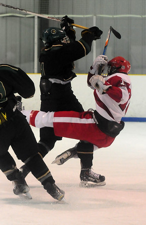 JIM VAIKNORAS/Staff photo Pentucket's Max Whitmyer checks Amesbury's Jared Daniels during their game at the Valley Forum in Haverhill Saturday night.