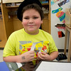 JIM VAIKNORAS/Staff photo  Jacob Rulli wears a chapeau as he talks about France at the Salisbury Elementary School 2nd grade Passport to Learning Friday afternoon. Each 2nd grader at the school made a display and gave a short presentation about their ethnic heritage.