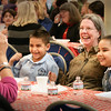 BRYAN EATON/Staff photo. Mary Clare Francis poses with her god-children Anthony Davis, 7, left, and Eva, 8, as their grandmother Loretta Gallagher takes their photo. They were at the annual Special Persons Lunch at the Immaculate Conception School in Newburyport where they were treated to a pizza party.