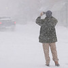 BRYAN EATON/Staff photo. Robert Bentley of Newburyport.com captures images of snow-covered State Street at the height of Thursday's storm.