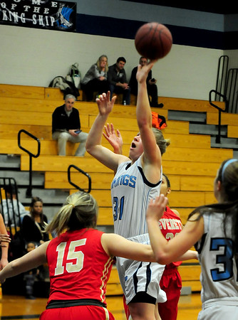 JIM VAIKNORAS/Staff photo Triton's Erin Savage with a floater against Everett Wednesday night at Triton.