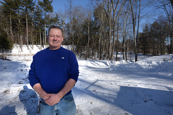 BRYAN EATON/Staff photo. South Hampton resident Mark Sullivan is hoping to use property he owns on Kimball Road in Amesbury for a controversial cell tower. He stands on the property in which Kimball Road is about 100 yards behind him to the right not far from the Newton, N.H. town line.