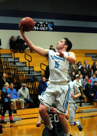 JIM VAIKNORAS/Staff photo Triton's Liam Spillane drives to the basket against Pentucket at Triton Friday night.