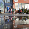 BRYAN EATON/Staff photo. Youngsters reflected in melted snow head in to the Boys and Girls Club in Salisbury on Wednesday afternoon. They may get a day off again as snow is expected to be heavy on Thursday, and when there's a snow day, the club closes also.