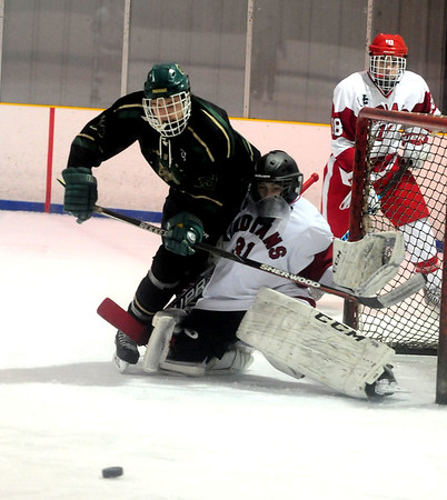 JIM VAIKNORAS/Staff photo Pentucket's Brendan Lincoln collides with Amesbury goalie Noah Hassan at the Valley Forum in Haverhill Saturday night.