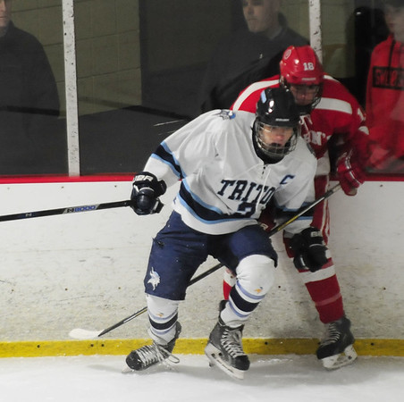 JIM VAIKNORAS/Staff photo Triton's Jed Cutter checks  St John's Vaughn Wahlberg during their game at the Graf Rink in Newburyport Monday night.
