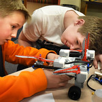 BRYAN EATON/Staff photo. Ben Norton, 10, left, and CJ Tirone, 11, work on a Lego robot that they're going to use to battle other robotic teams. They were in the afterschool program Explorati ...