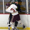 BRYAN EATON/Staff photo. Newburyport's Owen Bradbury checks Pentucket's Deuce Purcell.