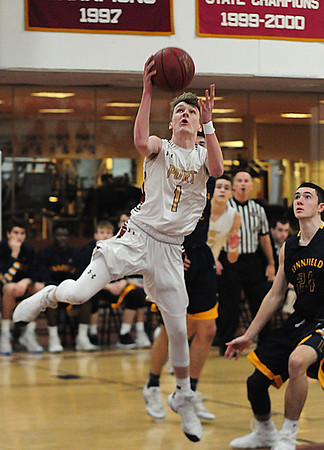 JIM VAIKNORAS/Staff photo Newburyport's Rob Shay drives to the basket against Lynnfield at Newburyport High School Friday night.