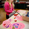 BRYAN EATON/Staff photo. Mia DesRosiers, 7, cuts out Valentine shapes in Karen Greenfield's art class at the Cashman School in Amesbury on Tuesday. The students were making assorted cards to take home to family members.
