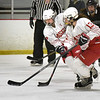 BRYAN EATON/Staff photo. Masconomet players Isabelle Sarra and Lexi Rosenbaum take the puck down rink.