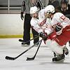 BRYAN EATON/Staff photo. Masconomet players Isabelle Sarra and Lexi Rosenbaum take the puck down rink.