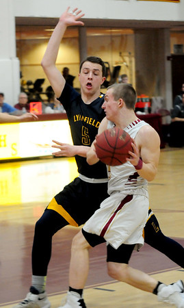 JIM VAIKNORAS/Staff photo Newburyport's  Nicholas Rogers drives to the basket  against Lynnfield at Newburyport High School Friday night.