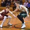 BRYAN EATON/Staff photo. Newburyport's Robert Shay looks to move around the Sachems' Steven Johanson.