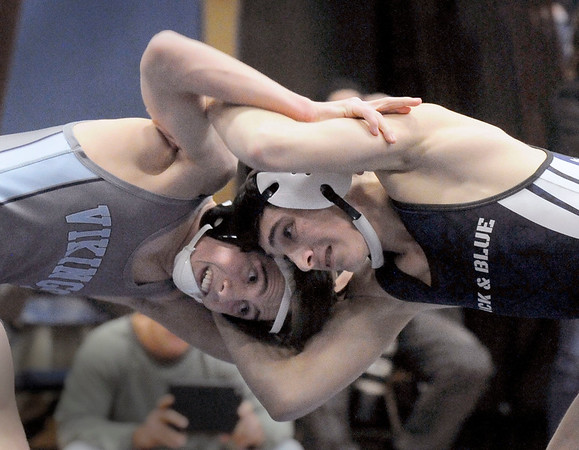 BRYAN EATON/Staff photo. Triton's Ethan Tremblay, left, with Marblehead/Swampscott's Stephen Hopkins.