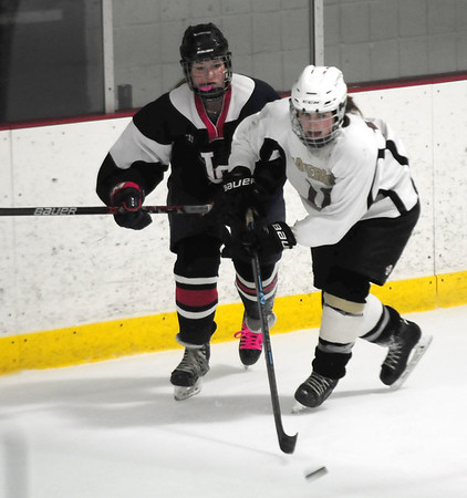 JIM VAIKNORAS/Staff photo HPHA's Jess Chicko controls the puck against Lynnfield at Veteran's Rink in Haverhill.
