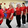 BRYAN EATON/Staff photo. Ladies in the zumba class at the Hilton Senior Center line up for their first performance on Wednesday. They were performing at the center's Valentine Luncheon.