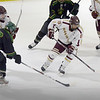 BRYAN EATON/Staff photo. Newburyport's Paul Federico moves the puck past Pentucket's Tom Long.