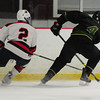 JIM VAIKNORAS/Staff photo Pentucket's Justin Fitzpatrick makes a move on Lynn's Sean Devin at the Graf Rink in Newburyport Wednesday night.