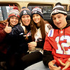 BRYAN EATON/Staff photo. Pentucket High School graduates dressed in Patriots' clothing took the Newburyport train to the parade in Boston. From left, Jillian Terry, Alyssa Richardson, Olivia Kemper and Brandon Barlow.
