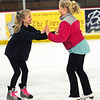 JIM VAIKNORAS/Staff photo  With all the outdoor ice melted or melting, Taryn Lebreck,11, in pink, and Josie Palmer, 11, both of Newburyport enjoy the open skate Saturday afternoon at the Graf Rink in Newburyport.