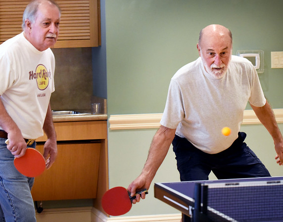BRYAN EATON/Staff photo. Bruce Merluzzi of Salisbury has his ping pong paddle ready for the hit as his teammate, Eric Peterson, left, of Byfield, is ready for the next volley. The two were at the Newburyport Senior Center on Tuesday afternoon when ping pong is played as well as on Friday.