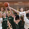 BRYAN EATON/Staff photo. Pentucket's Isabella Doyle grabs a rebound as Clippers' Olivia Olson and Paige Gouldthorpe cover.