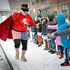 BRYAN EATON/Staff photo. Zero the Hero arrived by limousine to the Bresnahan School Tuesday to the thrill of the kindergartners gathered outside for the 100th day of school. The math crusader, a.k.a. Rob Ouellette, visits their classrooms the first half of the year to help children with math in multiples of 10's then makes his final visit on the 100th day of school followed by parties in the classrooms.