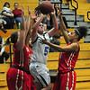 JIM VAIKNORAS/Staff photo Triton's Bridget Sheehan drives to the basket against Everett Wednesday night at Triton.