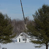 BRYAN EATON/Staff photo. A crane stands in the spot where a cell tower is proposed of Kimball Road in Amesbury near Lake Attitash. The height of the crane is the same as the proposed tower.