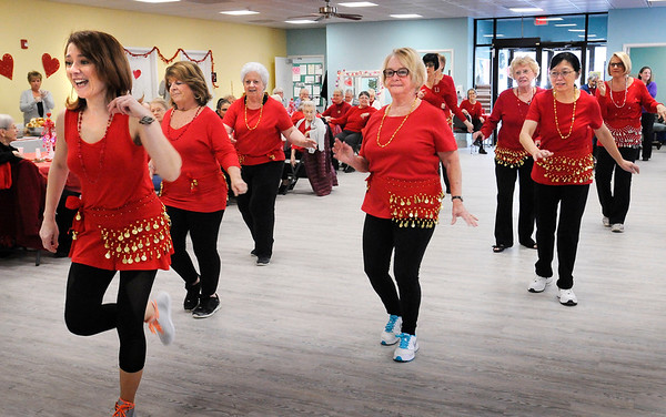 BRYAN EATON/Staff photo. Members of the Zumba class at the Hilton Center performs with their instructor Ivana Ruvkova, left. They were showcasing their talent before and after the Valentine's Luncheon.