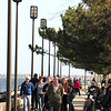 JIM VAIKNORAS/Staff photo People crowd the boardwalk at Market Landing Park in Newburyport Saturday on an unseasonably warm late February day.