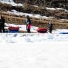 JIM VAIKNORAS/Staff photo Despite the unseasonably warm weather the past week, people still enjoy taking a few tubing runs at the Amesbury Sports Park Sunday morning.