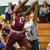 BRYAN EATON/Staff photo. Newburyport's Ronnie Mwai gets pressure from Pentucket's Nate McGrail.